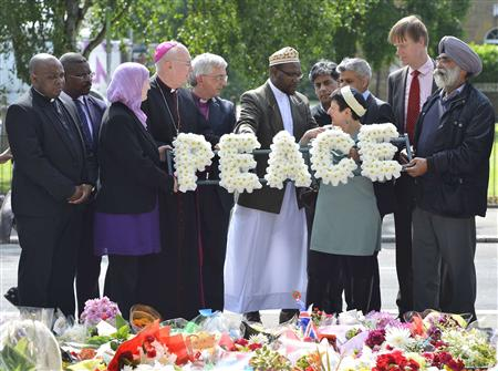 Local community representatives and faith leaders lay a floral tribute near the scene of the killing of British soldier Lee Rigby in Woolwich, southeast London May 31, 2013. REUTERS/Toby Melville