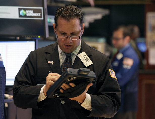 Trader Edward Curran works on the floor of the New York Stock Exchange Tuesday, July 31, 2012. U.S. stocks are opening mostly lower ahead of a two-day policy meeting at the Federal Reserve. Stocks ended slightly lower Tuesday as investors held back ahead of three critical events this week: policy meetings at both the Federal Reserve and the European Central Bank and a closely watched report on jobs in the U.S. (AP Photo/Richard Drew)