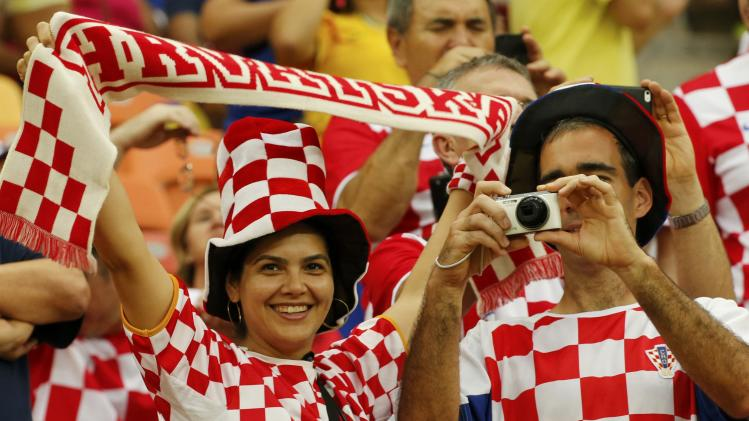Fans of Croatia cheer before the start of their 2014 World Cup Group A soccer match against Cameroon at the Amazonia arena in Manaus