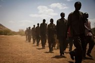 Sudan People's Liberation Movement (SPLA-N) rebel soldiers train in the Nuba Mountians, in South Kordofan, a region of Sudan, in April 2012. Sudan pledged on Thursday to cease hostilities with South Sudan in accordance with a UN Security Council resolution, hours after the South alleged fresh Sudanese bombing of its border region