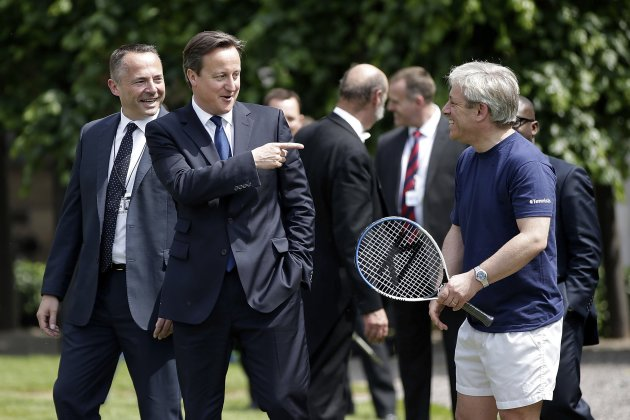 Britain's Prime Minister David Cameron gestures to Speaker John Bercow at a tennis event in the grounds of the Houses of Parliament in London