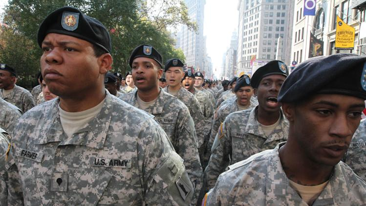 Members of the U.S. Army Reserves do cadence as they wait to march up New York's Fifth Avenue in the Veterans Day Parade Sunday Nov. 11, 2012.   (AP Photo/Tina Fineberg)