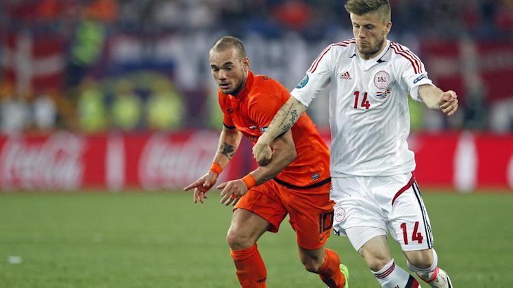 Wesley Sneijder from the Netherlands, left, and Denmark's Lasse Schone fight for possession during the Euro 2012 soccer championship Group B match between the Netherlands and Denmark in Kharkiv , Ukraine, Saturday, June 9, 2012. (AP Photo/Matthias Schrader)