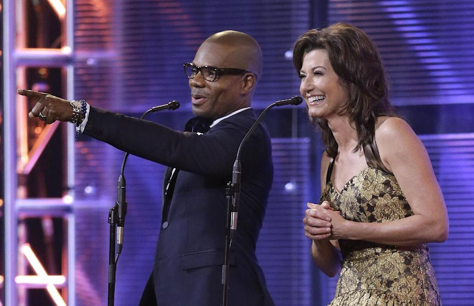Kirk Franklin and Amy Grant host the Dove Awards on Tuesday, Oct. 15, 2013, in Nashville, Tenn. (AP Photo/Mark Humphrey)