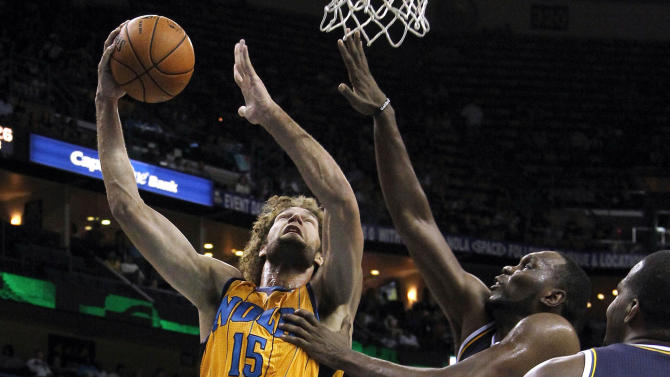 New Orleans Hornets center Robin Lopez (15) shoots over Utah Jazz center Al Jefferson (25) during the second half of an NBA basketball game in New Orleans, Friday, Nov. 2, 2012. The Hornets won 88-86. (AP Photo/Jonathan Bachman)