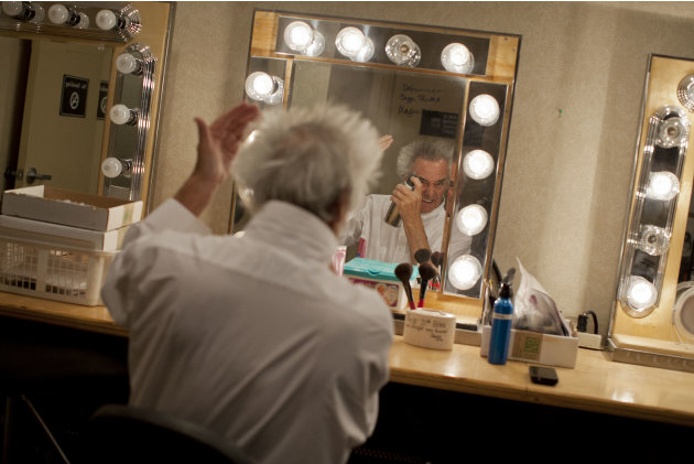 Brian Dewhurst puffs up his hair and applies some light make-up while preparing for one of two nightly performances as Brian Le Petit in Cirque Du Soleil's Mystere, Tuesday, May 22, 2012, at Treasure