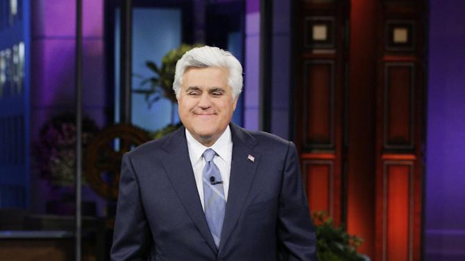 "This April 3, 2013 publicity photo released by NBC shows host Jay Leno on the set of ""The Tonight Show with Jay Leno,"" Season 21, Episode 4437, in Burbank, Calif. The role of female talk-show hosts in late-night TV network history, all 50-plus years of it, can be summed up in two words: Joan Rivers. It takes just another two _ Arsenio Hall _ to do the same for minorities. There's no indication that's going to change in the latest round of musical chairs involving ""Tonight"" and ""Late Night."" (AP Photo/NBC, Paul Drinkwater)"