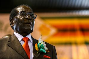 Zimbabwe President Robert Mugabe attends a meeting …