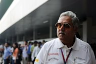 Force India team principal co-owner Vijay Mallya in the paddock at the Buddh International circuit in Greater Noida, on the outskirts of New Delhi on October 27, 2012. Force India insisted Thursday its Grand Prix team would be able to carry on despite co-owner Mallya's financial problems