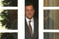 Spain&#39;s Prime Minister Mariano Rajoy in Madrid on June 7. Rajoy will hold a news conference on Sunday after Madrid secured a eurozone lifeline of up to 100 billion euros ($125 billion) to save the country&#39;s stricken banks, earning worldwide praise for steadying the European and global economies