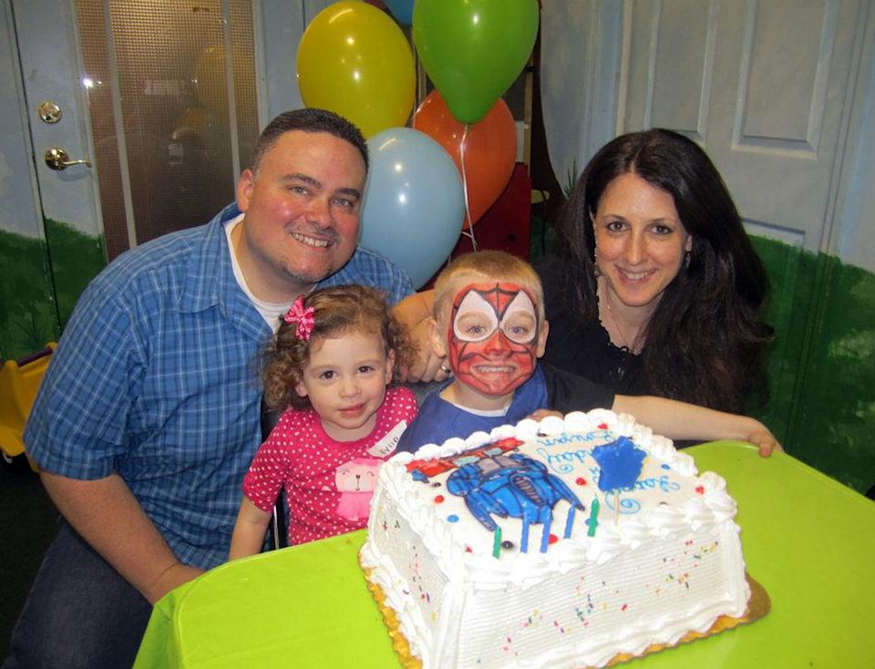 "This June 2012 photo taken from Facebook shows AP sports writer Dennis Waszak Jr., his wife, Daria, and their children. Waszak and his family moved into their Staten Island ""dream house"" just weeks before Superstorm Sandy devastated parts of the New York City borough. (AP Photo)"