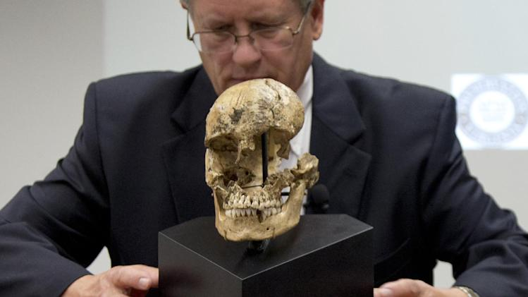 "Doug Owsley, division head for Physical Anthropology at the Smithsonian's National Museum of Natural History, displays the skull of  ""Jane of Jamestown"" during a news conference at the museum in Washington, Wednesday, May 1, 2013.  Scientists announced during the news conference that they have found the first solid archaeological evidence that some of the earliest American colonists at Jamestown, Va., survived harsh conditions by turning to cannibalism presenting the discovery of the bones of a 14-year-old girl, ""Jane"" that show clear signs that she was cannibalized. (AP Photo/Carolyn Kaster)"