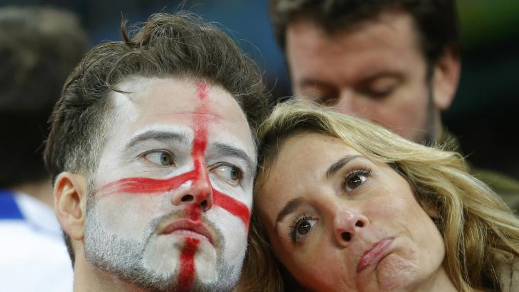 England fans react to their team losing to Uruguay during their 2014 World Cup Group D soccer match at the Corinthians arena in Sao Paulo