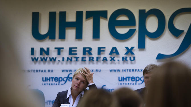 In this Thursday, Aug. 23, 2012 photo, Yevgenia Chirikova listens to a question during a news conference  Moscow. When the young mother of two embarked on her small and private campaign to save a forest in her town just outside Moscow, she had no clue that in order to gain the upper hand in this battle she would need to launch a nationwide campaign, hold a thousand-strong rally and ultimately run for mayor of that town. Environmental activist Yevgeniya Chirikova, a driving force behind a movement to save the forest in Khimki, is now running for mayor of that town which, thanks largely to her efforts, became one of the first battlegrounds of the anti-Kremlin protests. The Khimki vote could prove the first major electoral test for authorities and the opposition since the anti-Putin protests. (AP Photo/Sergey Ponomarev)