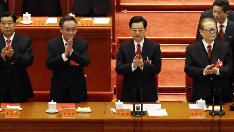Chinese leaders from left, Vice President Xi Jinping, Chairman of the Chinese People's Political Consultative Conference Jia Qinglin, National People's Congress ChairmanWu Bangguo, Chinese President Hu Jintao, former Chinese President Jiang Zemin and Chinese Premier Wen Jiabao applaud during the closing ceremony for the 18th Communist Party Congress held at the Great Hall of the People in Beijing Wednesday, Nov. 14, 2012. (AP Photo/Ng Han Guan)