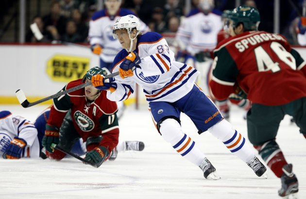 Edmonton Oilers right wing Ales Hemsky passes the puck during the first period of their NHL hockey game in St. Paul