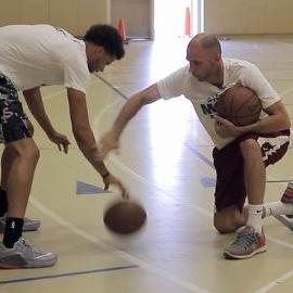 Michael Carter-Williams Performs Single-Arm Dribbling Drill with Contact