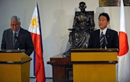 Philippine Foreign Affairs Secretary Albert del Rosario (L) and his Japanese counterpart Fumio Kishida are pictured at the foreign affairs office in Manila, on January 10, 2013. Kishida called for stronger ties with the Philippines to uphold Asian peace amid tense territorial disputes by the two countries with China