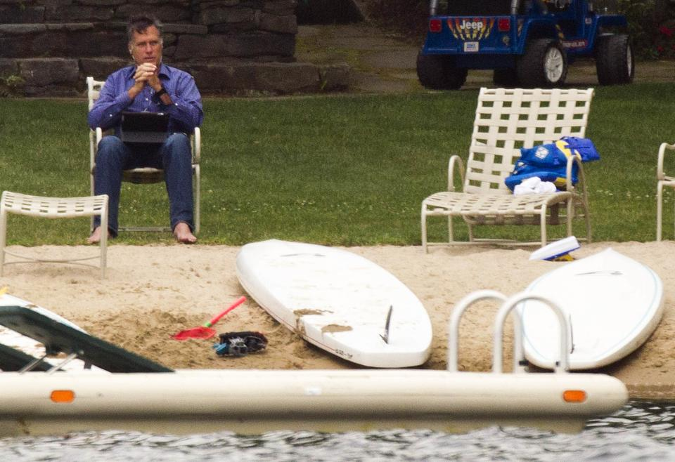 Republican presidential candidate, former Massachusetts Gov. Mitt Romney, sits by Lake Winnipesaukee at his home Saturday, July 14, 2012, in Wolfeboro, NH.  (AP Photo/Evan Vucci)