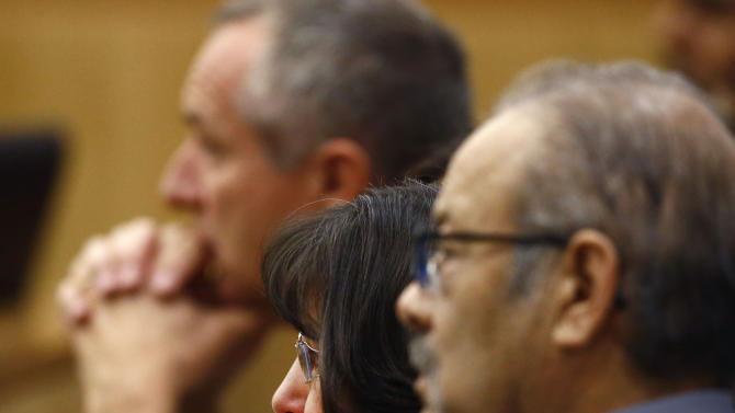 William Arias, right, and Sandra Arias watch their daughter Jodi Arias address the jury on Tuesday, May 21, 2013, during the penalty phase of her murder trial at Maricopa County Superior Court in Phoenix.  Arias was convicted of first-degree murder in the stabbing and shooting to death of Travis Alexander. (AP Photo/The Arizona Republic, Rob Schumacher, Pool)