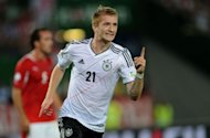 Germany's Marco Reus celebrates his goal against Austria during their 2014 World Cup qualification football match at the Ernst Happel Stadium, in Vienna. Germany edged a combative Austria 2-1 to confirm their top spot in Group C after Tuesday's 2014 World Cup qualifier in Vienna