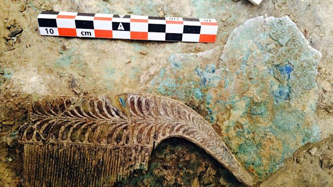 An undated picture released on October 26, 2105 by the Greek Culture Ministry shows an ivory comb, one of the items found in a 3,500 years old warrior tomb unearthed in the Peloponeese region of Greece