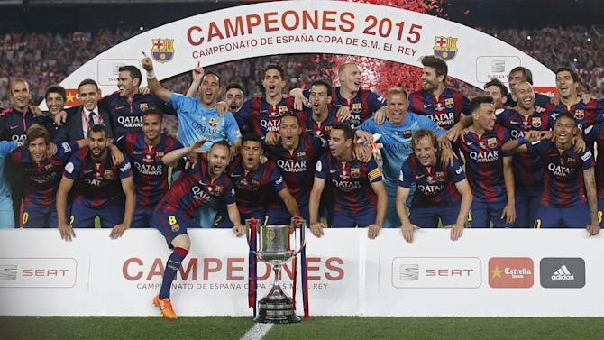 SOC: Barcelona celebrate with the trophy after winning the Spanish King's Cup Final