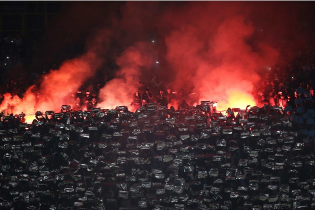 Napoli's supporters burn flares during the Italian Serie A soccer match against Juventus at the San Paolo Stadium in Naples