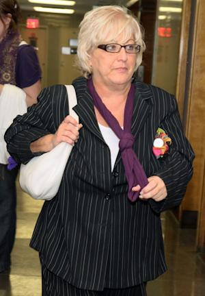 In this Sept. 23, 2011 photo, Barbara Sheehan leaves the courtroom in Queens State Supreme Court as her trial breaks for the day, in New York. Sheehan is accused of fatally shooting her retired police officer husband. Sheehan has pleaded not guilty saying the shooting was in self-defense. (AP Photo/Rick Maiman)