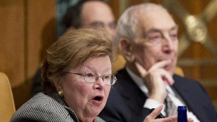 FILE - In this Dec. 5, 2012, file photo Sen. Barbara Mikulski, D-Md., left, with Sen. Frank Lautenberg, D-N.J., speaks to a witness during a hearing, to examine Hurricane Sandy, focusing on response and recovery and progress and challenges on Capitol Hill in Washington. Mikulski is set to take over as the first woman to chair the prestigious Senate Appropriations Committee, a position left open this week by the death of Hawaii Sen. Daniel Inouye. The Maryland Democrat was first elected to the Senate in 1986 after serving 10 years in the House and last year became the longest-serving woman in Senate history. With her ascendancy to the chairmanship of Appropriations, she enters a male-dominated realm that in the past has had sweeping power in deciding how the federal dollar will be dispersed around the country. (AP Photo/Manuel Balce Ceneta, File)