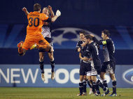 Dinamo players clebrate their opening goal during the Champions League group D soccer match between Dinamo Zagreb and Lyon, in Zagreb, Croatia, Wednesday, Dec. 7, 2011. (AP Photo/Darko Bandic)