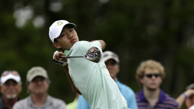 Guan Tianlang, 14, of China, tees off at the eighth hole during the second round of the Zurich Classic golf tournament at TPC Louisiana in Avondale, La., Friday, April 26, 2013. (AP Photo/Gerald Herbert)