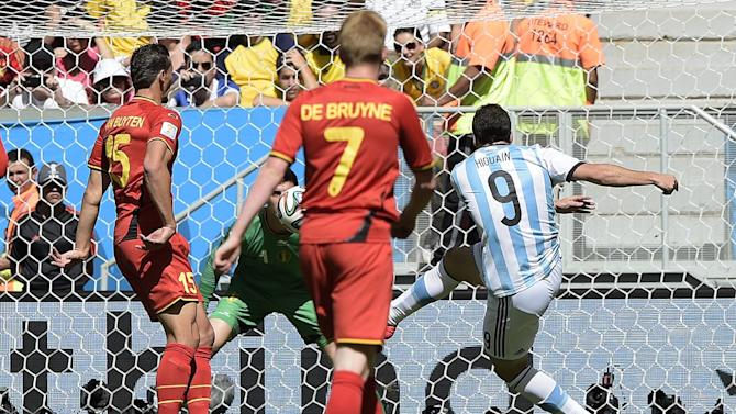 Argentina's forward Gonzalo Higuain (R) shoots to score during a quarter-final football match between Argentina and Belgium at the Mane Garrincha National Stadium in Brasilia during the 2014 FIFA World Cup on July 5, 2014
