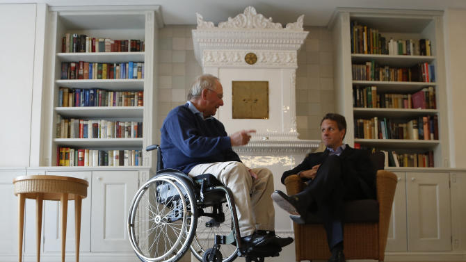 German Finance Minister Wolfgang Schaeuble, left, speaks with U.S. Treasury Secretary Timothy Geithner, right,  in the house where Schaeuble is vacationing, in Westerland on the German North Sea island of Sylt, Monday July 30, 2012. (AP Photo/dapd/ Philipp Guelland)