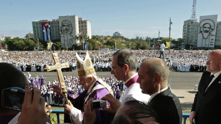 FILE - In this March 28, 2012 file photo, Pope Benedict XVI waves to faithful as he arrives to lead a Mass at Revolution Square in Havana, Cuba. On Monday, Feb. 11, 2013 the Vatican announced that Pope Benedict XVI will resign on Feb. 28, 2013. (AP Photo/Gregorio Borgia, file)
