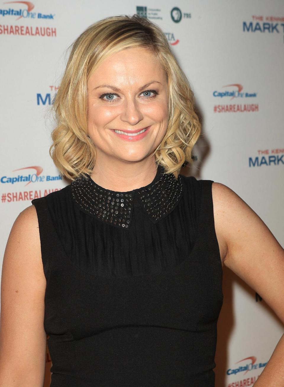 Amy Poehler arrives at 16th Annual Mark Twain Prize presented to Carol Burnett at the Kennedy Center on Sunday, Oct. 20, 2013 in Washington, D.C. (Photo by Owen Sweeney/Invision/AP)