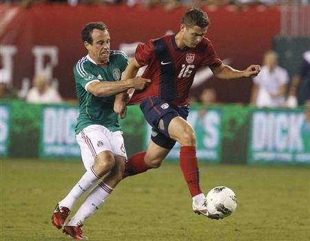U.S. midfielder Robbie Rogers is pulled down by Mexico defender Gerardo Torrado during the second half of their friendly soccer match in Philadelphia