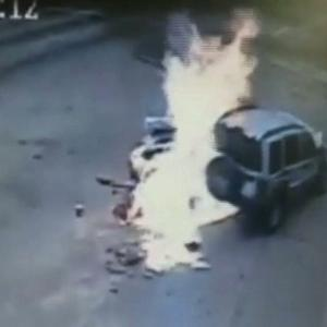 Raw: Woman Injured in Fiery Gas Station Crash