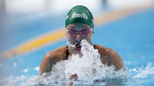 Ruta Meilutyte competes in the women's 100m breaststroke heats during the World Swimming Championships at the Sant Jordi arena in Barcelona (Reuters)