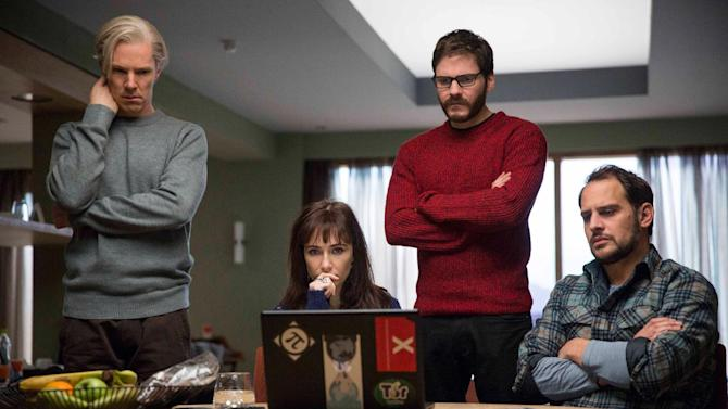 """This film publicity image released by Toronto International Film Festival shows, from left, Benedict Cumberbatch, Carice van Houten, Daniel Bruhl and Moritz Bleibtreu in a scene from """"The Fifth Estate,"""" being shown during the Toronto International Film Festival. (AP Photo/Toronto International Film Festival, Frank Connor)"""
