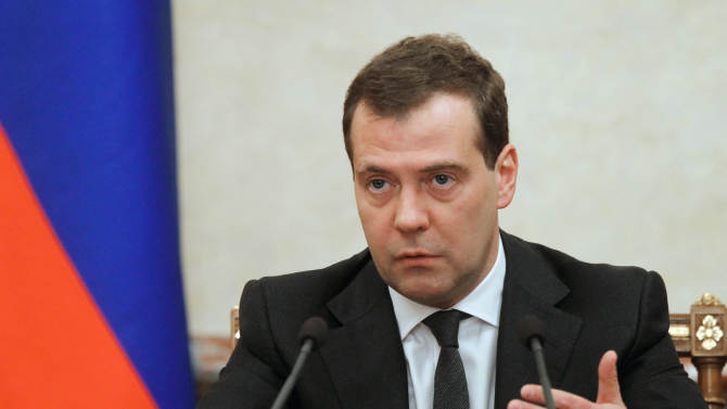 Russian Prime Minister Dmitry Medvedev chairs a Cabinet meeting in Moscow, Russia, on Thursday, Feb. 7, 2013.  Medvedev said he has no immediate intention of reversing his decision to leave Russia on Summer Time all year-round.  Medvedev ruled in 2011 that Russia would remain permanently fixed on Summer Time, but the rule has proved widely unpopular and President Putin has indicated that he may reverse the decision. (AP Photo/RIA-Novosti, Dmitry Astakhov, Government Press Service)