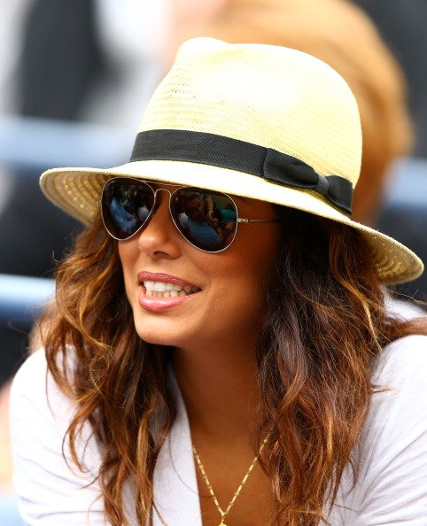Actress Eva Longoria looks on as Serena Williams of the United States plays against Andrea Hlavackova of Czech Republic during their women's singles fourth round match on Day Eight of the 2012 US Open