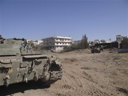 A view shows tanks and military vehicles that belonged to forces loyal to Syria's President Bashar al-Assad in Deraa
