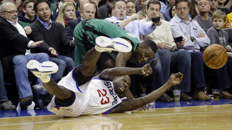 Philadelphia 76ers' Jason Richardson, bottom, passes the ball away from Boston Celtics' Jeff Green in the first half of an NBA basketball game, Friday, Dec. 7, 2012, in Philadelphia. (AP Photo/Matt Slocum)