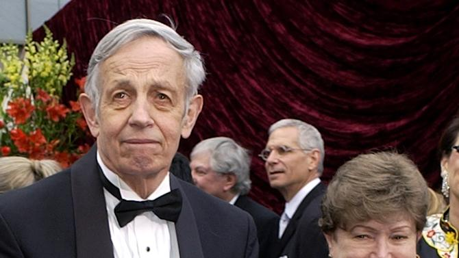 """FILE - In this March 24, 2002 file photo, John Nash, left, and his wife Alicia, arrive at the 74th annual Academy Awards, in Los Angeles. Nash, the Nobel Prize-winning mathematician whose struggle with schizophrenia was chronicled in the 2001 movie """"A Beautiful Mind,"""" died in a car crash along with his wife in New Jersey on Saturday, May 23, 2015, police said. (AP Photo/Laura Rauch, File)"""