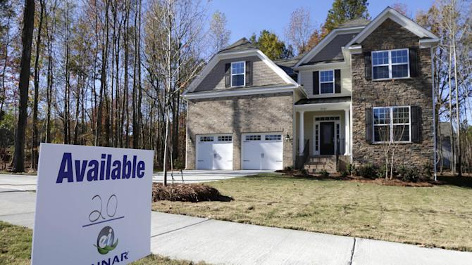FILE - In this Nov. 14, 2013 file photo, a home is advertised for sale in Matthews, N.C. Standard & Poor's releases S&P/Case-Shiller index of home prices for October on Tuesday, Dec. 31, 2013. (AP Photo/Chuck Burton, File)
