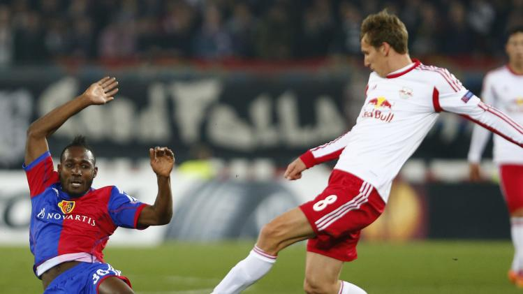 FC Basel's Sio fights for the ball with Klein of FC Salzburg during their Europa League round of 16 match in Basel