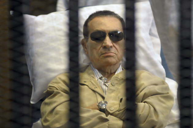 Egypt&#39;s ex-President Hosni Mubarak lays on a gurney inside a barred cage in the police academy courthouse in Cairo, Egypt, Saturday, June 2, 2012. Mubarak was sentenced to life in prison Saturday for his role in the killing of protesters during last year&#39;s revolution that forced him from power, a verdict that caps a stunning fall from grace for a man who ruled the country as his personal fiefdom for nearly three decades.(AP Photo)
