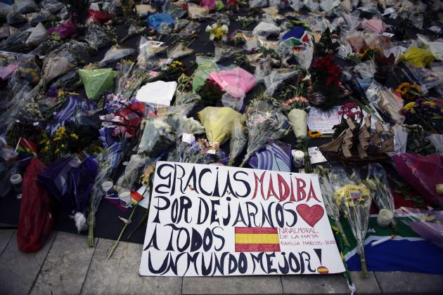 Flowers and written tributes are seen at Mandela square in Johannesburg
