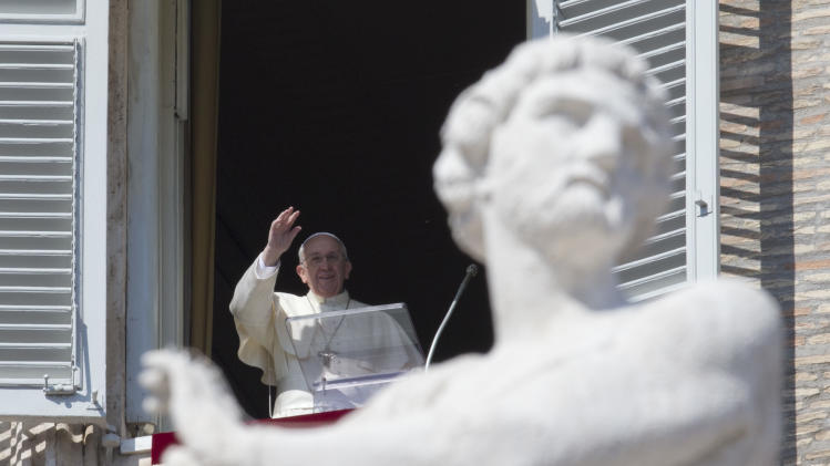 Pope Francis delivers his blessing during the Angelus noon prayer he celebrated from the window of his studio overlooking St. Peter's Square, at the Vatican, Sunday, March 9, 2014. (AP Photo/Andrew Medichini)